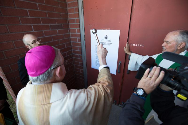 Los Angeles Archbishop Jose H. Gomez blesses the doors of the chapel of the Barry Nidorf Juvenile Hall near Los Angeles Jan. 23. The prison entrance was designated a Door of Mercy to mark the church's Jubilee Year of Mercy. (CNS photo/Victor Aleman, Vida Nueva)
