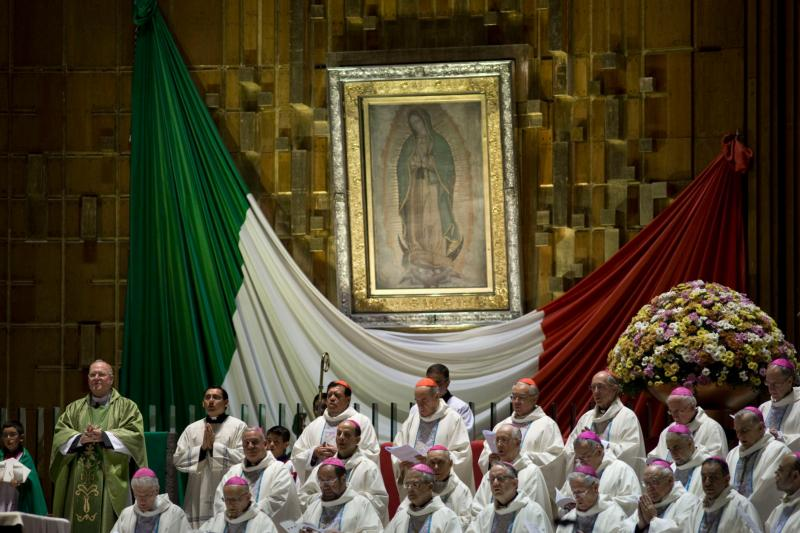 New York Cardinal Timothy M. Dolan, left, celebrates Mass in 2013 alongside other prelates at the Basilica of Our Lady of Guadalupe in Mexico City. In a video message one week before his apostolic visit, Pope Francis asked the people of Mexico for some time alone during his visit to pray before the image of Our Lady of Guadalupe. (CNS photo/David Maung)