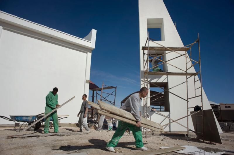 Inmates at the Chihuahua state prison in Ciudad Juarez, Mexico, work on remodeling the chapel in the men's section of the prison Jan. 28. The  chapel is being remodeled for a visit by Pope Francis, scheduled for Feb.17. (CNS photo/David Maung)