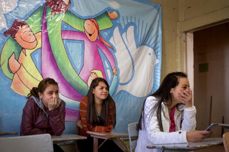 Teenage girls attend the first meeting of a newly formed youth ministry group Jan. 31 at Corpus Christi Parish in Ciudad Juarez, Mexico. (CNS photo/David Maung)