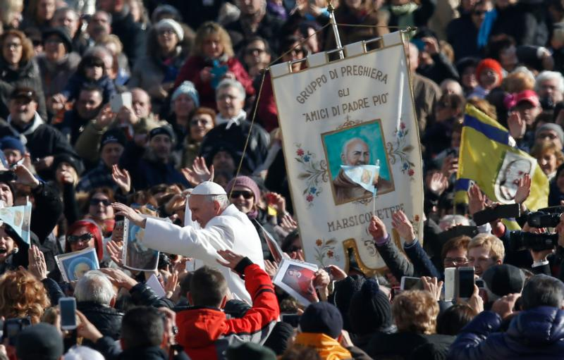 Pope Francis greets the crowd during an audience with St. Padre Pio prayer groups from around the world in St. Peter's Square at the Vatican Feb. 6. The bodies of Padre Pio and St. Leopold Mandic were brought to Rome at the request of Pope Francis for the Year of Mercy. (CNS photo/Paul Haring)