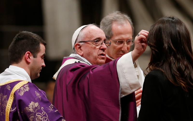 Pope Francis gives ashes to a woman as he celebrates Ash Wednesday Mass in St. Peter's Basilica at the Vatican Feb. 10. (CNS photo/Paul Haring)