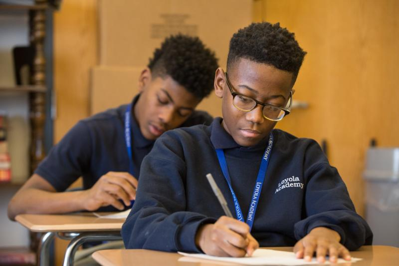 Camren Hamilton writes and essay during English class Feb. 10 at the Jesuit-run Loyola Academy of St. Louis middle school. The Nativity School concept was pioneered by Jesuits in American inner cities beginning in the early 1970s. (CNS photo/Lisa Johnston, St. Louis Review)