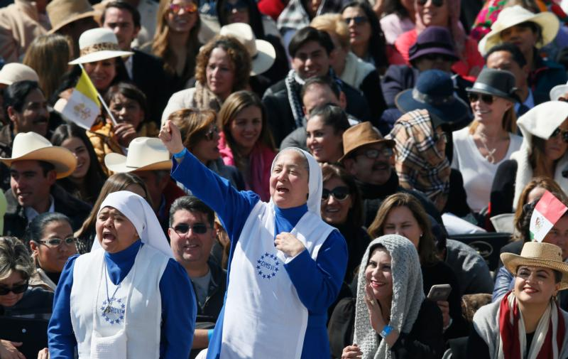 Nuns cheer as they wait for Pope Francis' arrival to celebrate Mass in Ecatepec near Mexico City Feb. 14. (CNS photo/Paul Haring)