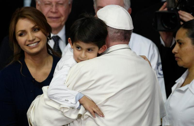 Pope Francis embraces Rodrigo Lopez Miranda, 5, as he visits the Federico Gomez Children's Hospital of Mexico in Mexico City Feb. 14. At left is Mexico's first lady Angelica Rivera. (CNS photo/Paul Haring)