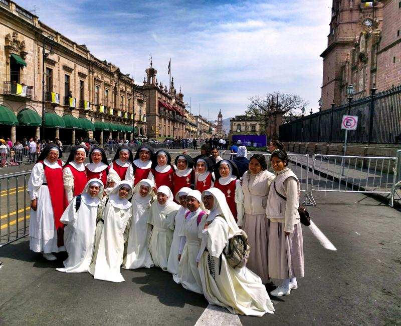 Women religious pose for a photo outside the Cathedral of Morelia in the state of Michoacan, Mexico, Feb. 15. Pope Francis will visit the church prior to his meeting with youth. (CNS photo/Junno Arocho Esteves)
