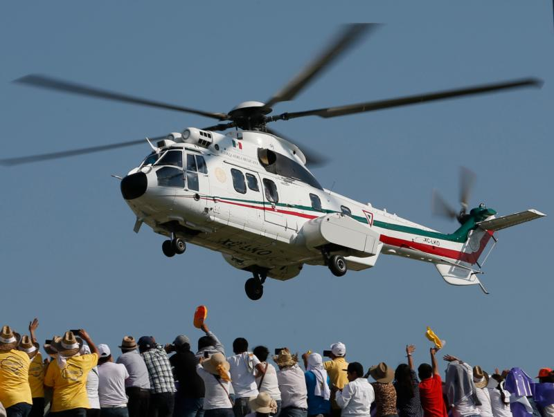 Pope Francis waves from a helicopter to people gathered in Victor Manuel Reyna Stadium for a meeting with families in Tuxtla Gutierrez, Mexico, Feb. 15. (CNS photo/Paul Haring)