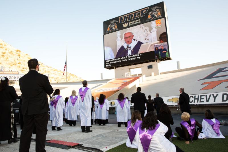Catholics watch Pope Francis celebrate Mass in nearby Ciudad Juarez, Mexico, on a big screen at El Paso's Sun Bowl Feb. 17. (CNS photo/Ron Wu, Catholic Extension)