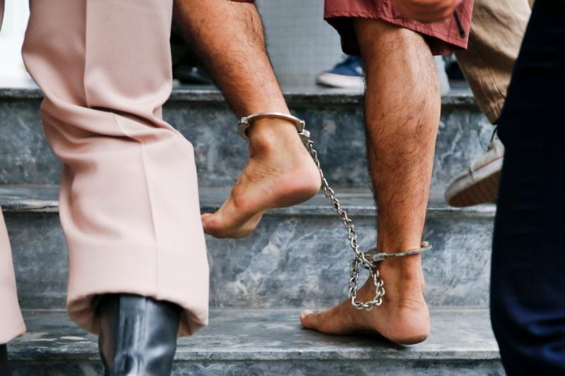 The shackled feet of a bombing suspect in Bangkok, Thailand, are seen as he is escorted by officers and prison personnel to Military Court Feb. 16. Pope Francis asks world leaders for a Jubilee Year moratorium on the death penalty. (CNS photo/Diego Azubel, EPA)