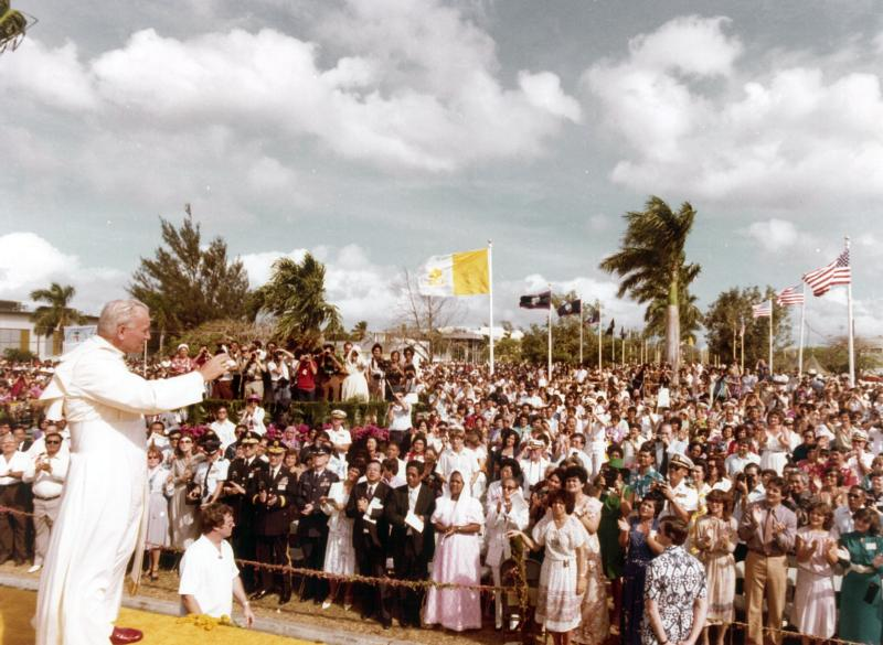Pope John Paul II, the future saint, greets people before celebrating an outdoor Mass in Hagatna, Guam, Feb. 23, 1981. (CNS photo/courtesy Archdiocese of Agana)