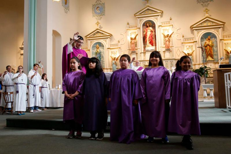A blessing is given to child catechumens during Mass at Sacred Heart Parish in El Paso, Texas, Feb. 14. Those to receive sacraments of Christian initiation at Easter made their final preparations for joining the Catholic Church during Lent. (CNS photo/Nancy Wiechec)