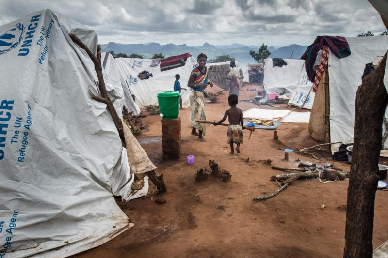 A Mozambican refugee walks towards his mother in Mwanza, Malawi, Feb. 7. Malaria and cold nights add to the suffering of the increasing number of Mozambicans arriving at a makeshift camp in Malawi to escape violence at home, said a church worker in Malawi. (CNS photo/Erico Waga, EPA)