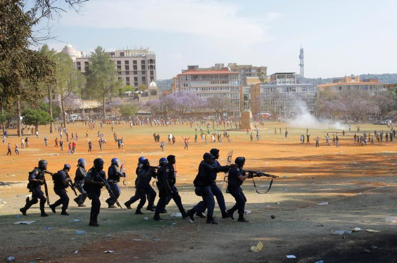 Police forces clash with protesters at the Union Buildings in Pretoria, South Africa, in this Oct. 23, 2015, file photo. (CNS photo/Kim Ludbrook, EPA)