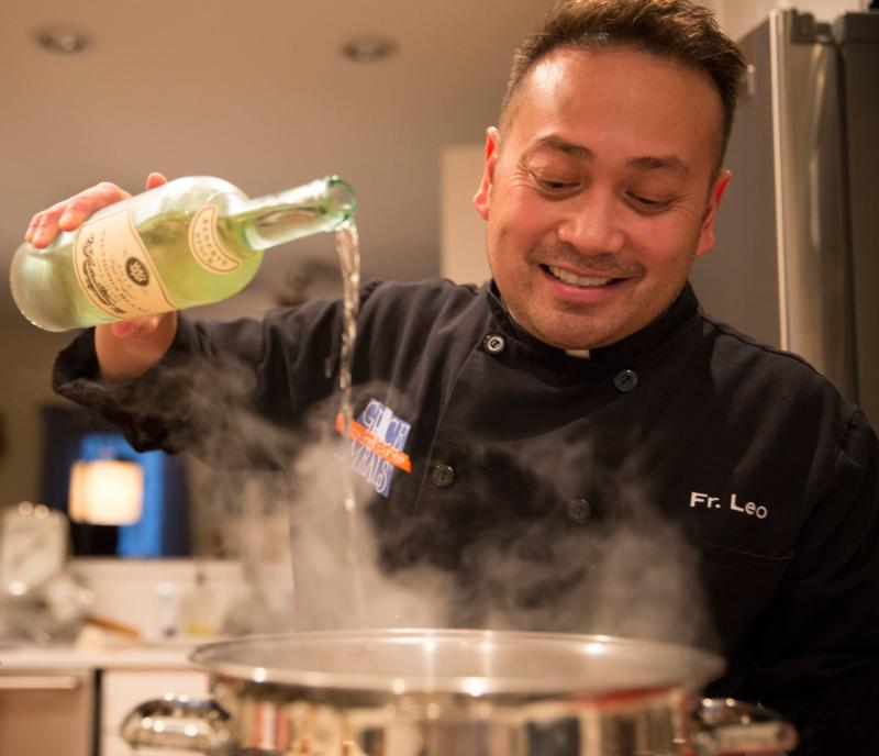 Celebrity chef Father Leo Patalinghug demonstrates how to cook a Lenten seafood pasta meal in his Baltimore kitchen Feb. 24. (CNS photo/Chaz Muth)
