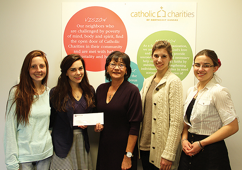 Members of Atchison's Benedictine College Presidential Ambassadors present a check to Catholic Charities of Northeast Kansas. Pictured from left are: Sarah Salter, Lucy Leighton, Cindy Gillispie of Catholic Charities, Mary Catherine Willackers and Victoria Finders.