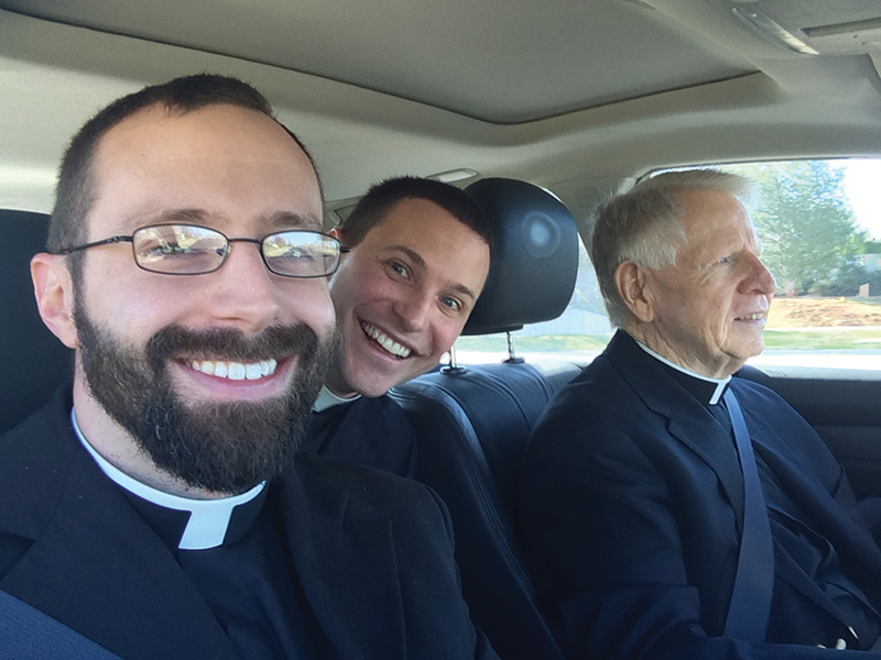 Father Nathan Haverland (left) has mastered the art of the selfie. In 2014, he published a selfie calendar that was so successful, it paved the way for another calendar in 2015. He is pictured here with Father Alessandro Borraccia (center) and Msgr. Tom Tank (right).