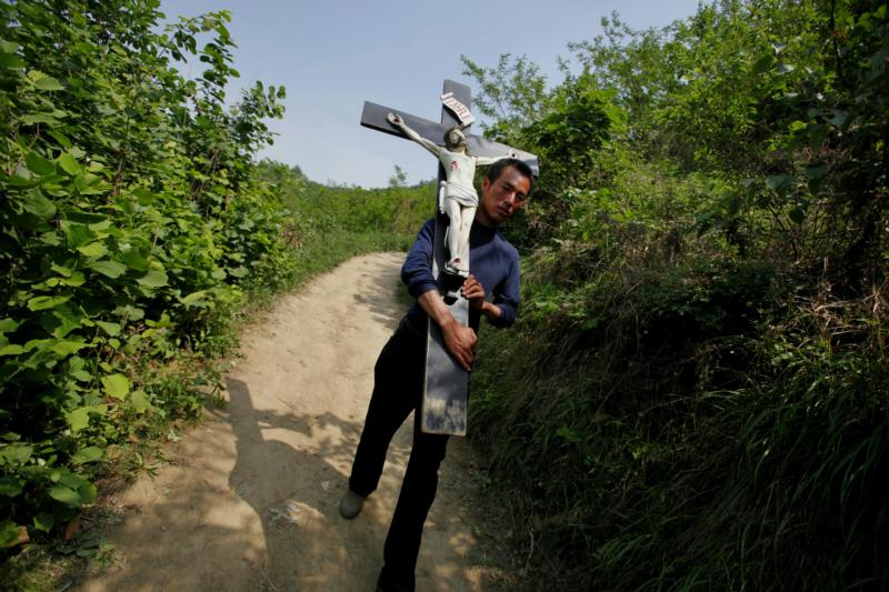 In this 2013 file photo, a Chinese Catholic carries a crucifix during a pilgrimage in the Shaanxi province of China. (CNS photo/Wu Hong, EPA)