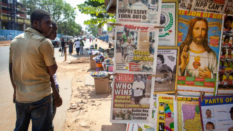 Men in Accra, Ghana, look at a newspaper stand in this Dec. 8, 2012, file photo. West African bishops urge Catholics to defend traditional marriage as influences from other nations are offered as keys to development. (CNS photo/Gabriela Barnuevo, EPA)
