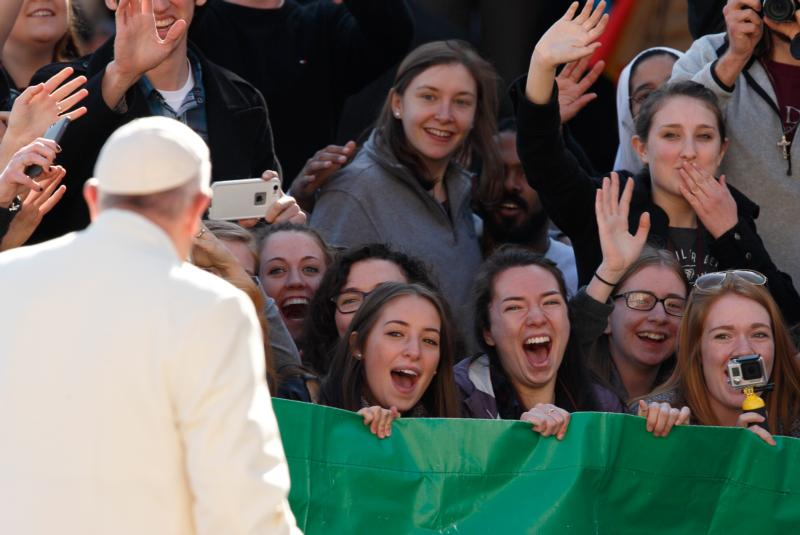 Students from the Austrian program of Franciscan University of Steubenville react as Pope Francis greets the crowd during his general audience in St. Peter's Square at the Vatican March 2. (CNS photo/Paul Haring)