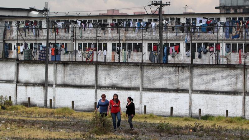 Relatives of inmates walk near La Modelo prison in Bogota, Colombia, in this Aug. 9, 2013, file photo. (CNS photo/Mauricio Duenas Castaneda, EPA)