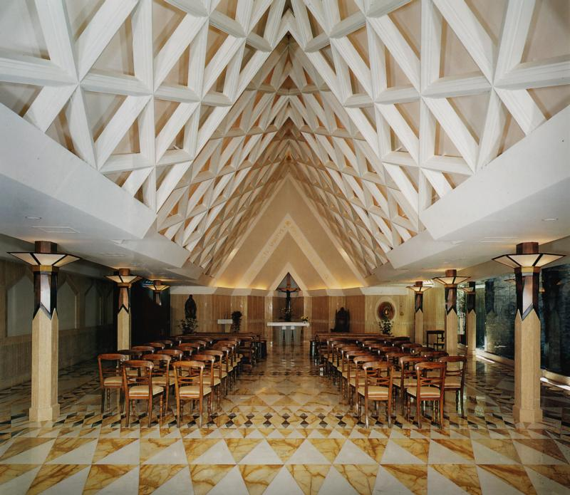 The interior of the Chapel of the Holy Spirit in Rome is seen in this undated photo. The chapel is the only building at the Vatican designed by an American. Pittsburgh architect Louis Astorino used triangles throughout the design to symbolize the Trinity. (CNS photo/courtesy of Astorino)