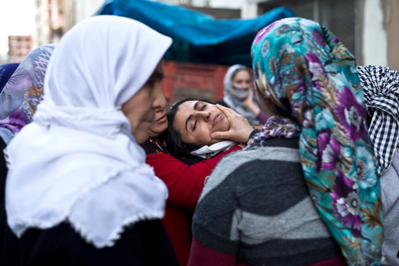 Kurdish women mourn during a funeral ceremony in Sirnak, Turkey, Jan. 10. The U.S. House Foreign Affairs Committee March 2 unanimously passes two bipartisan measures to address war crimes and genocide in Middle East. (CNS photo/Refik Tekin, EPA)