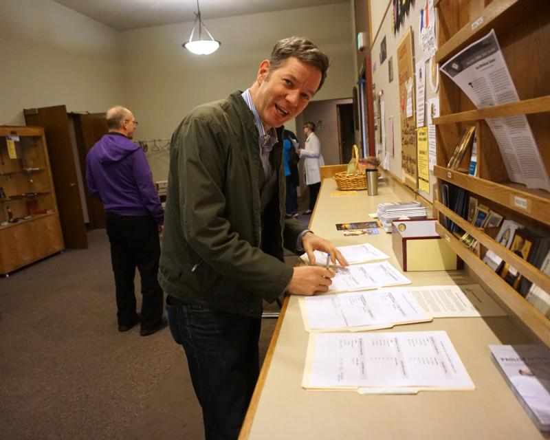 Oregon Rep. Rob Nosse signs up for ministries at St. Philip Neri Church in Portland March 2. The Democrat said his Catholic faith informed his vote for a new minimum wage measure. (CNS photo/Kristen Hannum, The Catholic Sentinel)