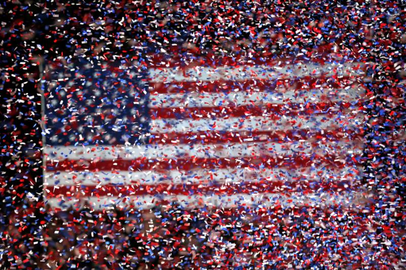 Confetti rains in front of a U.S. flag in Chicago in this Nov. 3, 2012, file photo. (CNS photo/Kamil Krzaczynski, EPA)