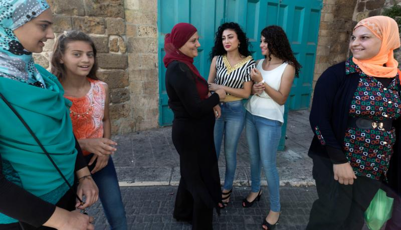 Arab woman mix with more traditionally dressed women in Akko, Israel, in this Aug. 9, 2013, file photo. (CNS photo/Jim Hollander, EPA)