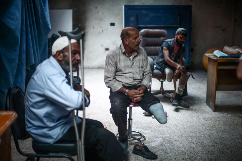 Syrian men who lost limbs during the civil war get prosthetic legs in Hamorya, Syria, in this Oct. 22, 2015, file photo. (CNS photo/Mohammed Badra, EPA)