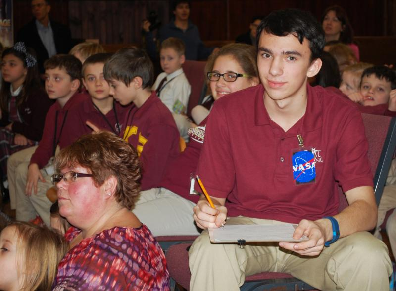 Christ the King School eighth-grader Michael Blais, of Rutland, Vt., records information from the International Space Station during the Feb. 4 assembly. (CNS photo/Cori Fugere Urban, Vermont Catholic)