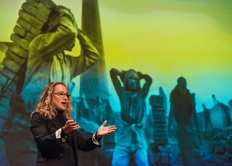 Photographer Lisa Kristine gives a presentation at St. Norbert College in De Pere, Wis., March 1, about her work photographing human trafficking around the world. (CNS photo/Sam Lucero, The Compass)