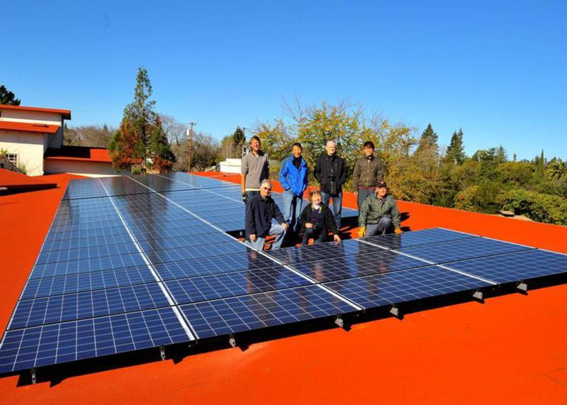 """Parishioners of St. Thomas Aquinas in Palo Alto, Calif., pose next to solar panels in this undated 2015 file photo. The Archdiocese of San Francisco is launching a """"Laudato Si'"""" initiative to help parishes respond to Pope Francis' 2015 encyclical and form """"care for creation"""" teams. (CNS photo/courtesy St. Thomas Aquinas Parish)"""
