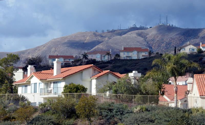 """General view of homes affected by a mountain gas leak in Porter Ranch, Calif., Jan. 7. For all the attention Pope Francis' encyclical """"Laudato Si', on Care for Our Common Home"""" has gained, little has been made of the connection among Catholic tradition, the natural world and science that the document addresses. (CNS photo/Mike Nelson, EPA)"""