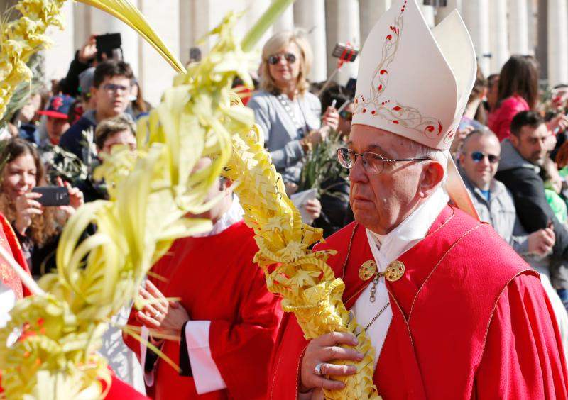 Pope Francis carries palm fronds in procession during Palm Sunday Mass in St. Peter's Square at the Vatican March 20. (CNS photo/Paul Haring)