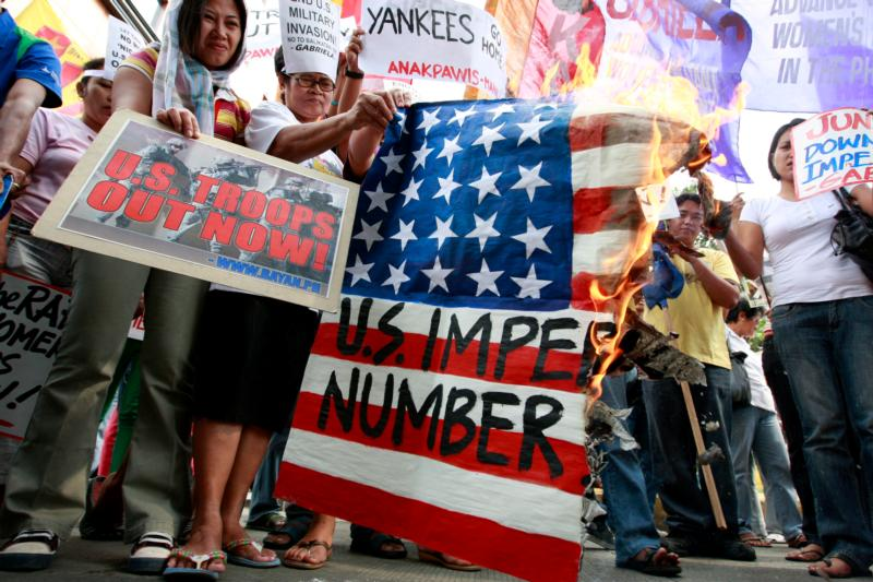 Filipinos protest joint military exercises with the U.S. in Manila, in this Feb. 4, 2009, file photo. Several Philippine bishops express opposition to the planned building of U.S. military facilities in five Philippine provinces in the coming months. (CNS photo/Dennis M. Sabangan, EPA)