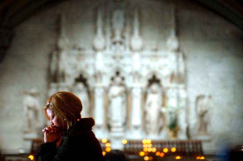 A woman prays at St. Patrick's Cathedral in New York in this April 1, 2005, file photo. (CNS photo/Justin Lane, EPA)