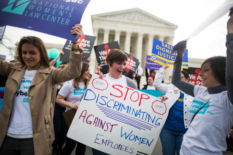 Women lobby in support of the Affordable Care Act's contraceptive mandate March 23 outside the U.S. Supreme Court ahead of oral arguments in Zubik v. Burwell in Washington. (CNS photo/Jim Lo Scalzo, EPA)
