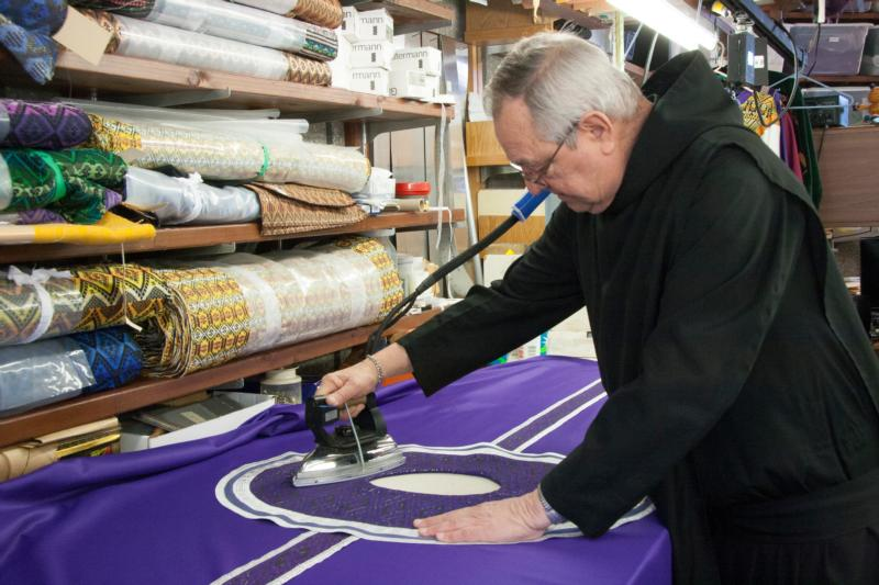 Brother Sebastian Goldade, a member of the Missionary Benedictines, irons a chasuble designed for Lent in his liturgical vestments workshop Feb. 19 at the Christ the King Priory in Schuyler, Neb. He began his vestments ministry 50 years ago at the now-closed Blue Cloud Abbey in northeast South Dakota. (CNS photo/Joe Ruff, Catholic Voice)