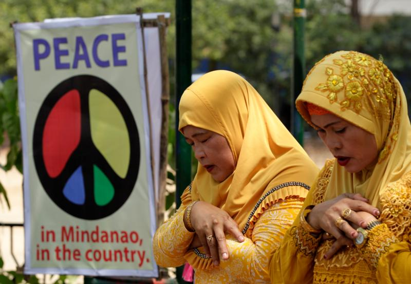 Muslims pray during the 'All-out-peace' campaign in 2015 near Manila, Philippines. The campaign aims to take a stand for peace by any form of armed violence or war as a response to the Mindanao island conflicts in southern Philippines. (CNS photo/Ritchie B. Tongo, EPA)