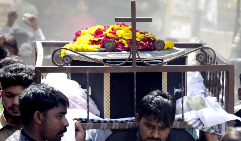 People carry a coffin March 28 after the previous day's suicide bomb attack at a park in Lahore, Pakistan. Observers say the terrorist attack that killed more than 70 people in a Lahore park on Easter was not the first time that Christians in the Islamic country have been targeted. (CNS photo/Rahat Dar, EPA)