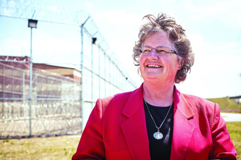 Benedictine Sister Kathleen Atkinson poses for a photo outside the North Dakota State Penitentiary in Bismarck, April 30, 2015. (CNS photo/courtesy Catholic Extension)