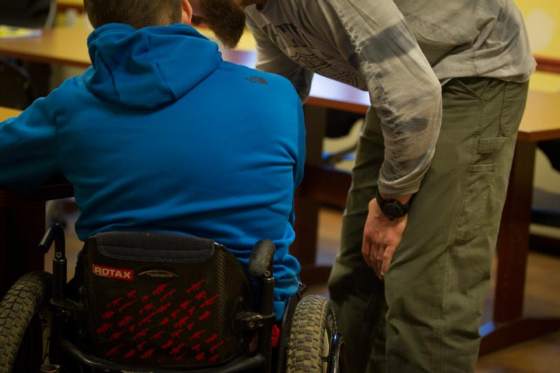 Two veterans get ready for a group session to begin Feb. 5 at St. Joseph's Addiction Treatment & Recovery Centers in Saranac Lake, N.Y. St. Joseph's opened its long-term-residential facility for military veterans in 2014. (CNS photo/Chaz Muth)