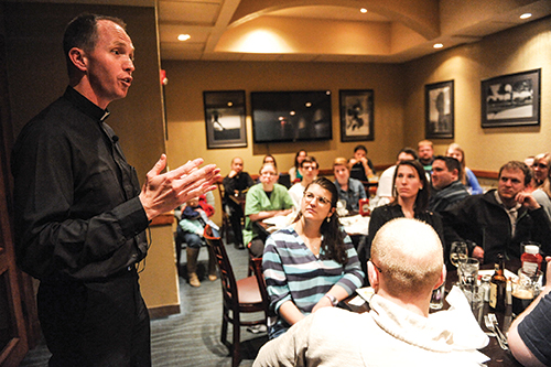 Father Nick Blaha, chaplain of the Didde Catholic Campus Center at Emporia State University, talks to the Credo group about the meaning of the Year of Mercy and how it applies to everyday life. Leaven photo by Joe McSorley