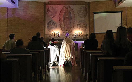 """Leaven photo by Eileen Wittig Archbishop Joseph F. Naumann leads eucharistic adoration at a """"Trust One Greater"""" event at Benedictine College in Atchison on March 2. In addition to leading adoration, the archbishop met with the college students for a Q&A."""