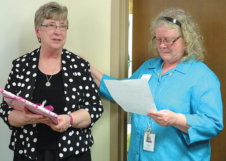 Keeler Women's Center director Sister Bridget Dickason (right) gives a speech of gratitude for the accomplishments of the center's foundress and outgoing director Sister Carol Ann Petersen during an open house in the latter's honor. Leaven photo by Jill Ragar Esfeld