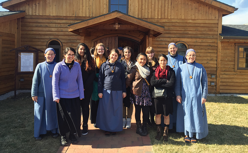 "Young women from the archdiocese pose for a picture with the Little Sisters of the Lamb in Kansas City, Kansas, on a visit to their convent. This was one of four stops on a vocations ""run,"" which allowed the high school students to take a look at life in several different religious orders."