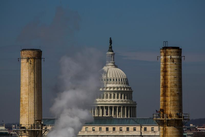 The dome of the U.S. Capitol is seen behind the smokestacks of the only coal-burning power plant in Washington in this March 10, 2014, file photo. (CNS photo/Jim Lo Scalzo, EPA)