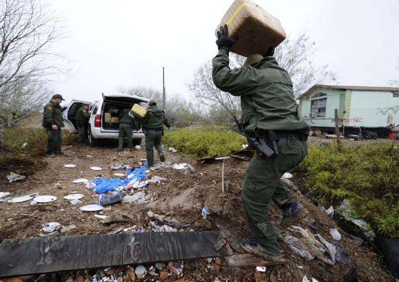 U.S. Border Patrol agents remove nearly 500 pounds of marijuana hidden in a trash dump in Garceno, Texas, in this Feb. 9, 2012, file photo. (CNS photo/Larry W. Smith, EPA)