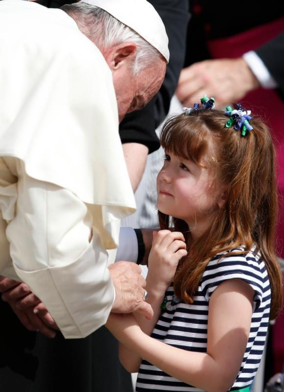 "Pope Francis greets Lizzy Myers of Mansfield, Ohio, during his general audience in St. Peter's Square at the Vatican April 6. Myers, who has a disease that is gradually rendering her blind and deaf, met the pope as part of her ""visual bucket list."" (CNS photo/Paul Haring)"